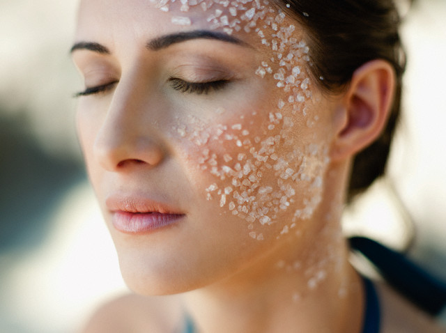 Young woman with sea salt on her face