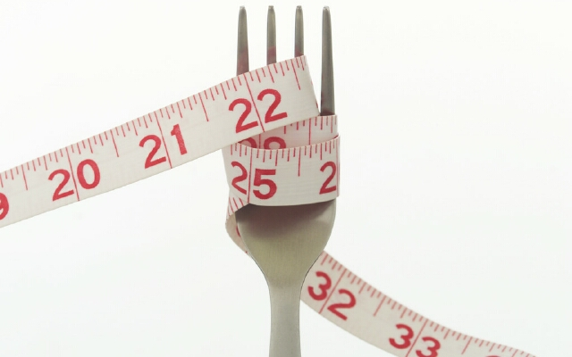 Measuring Tape Wrapped Around Fork