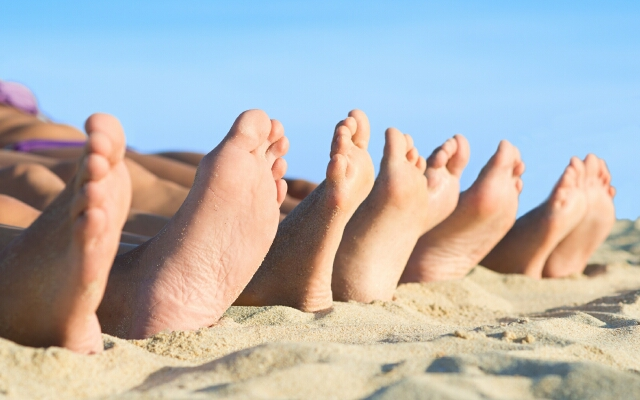 Close-up Of Bare Feet